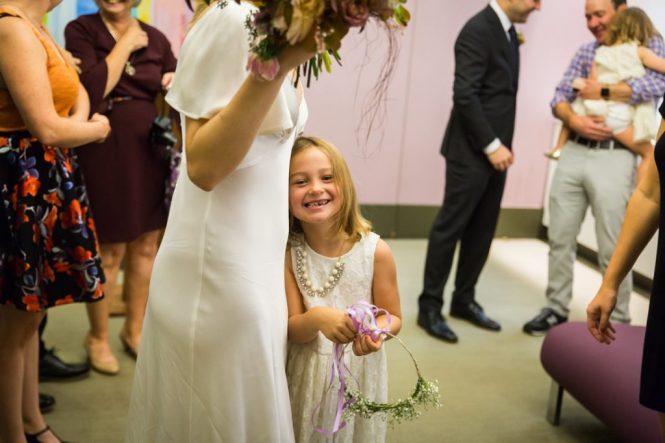 Bride and flower girl for an article on How to Get Married at City Hall in Any NYC Borough