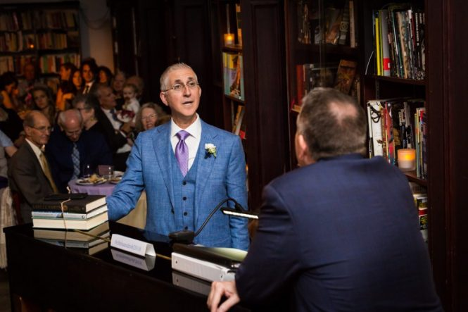 Grooms singing at a Housing Works Bookstore Cafe wedding