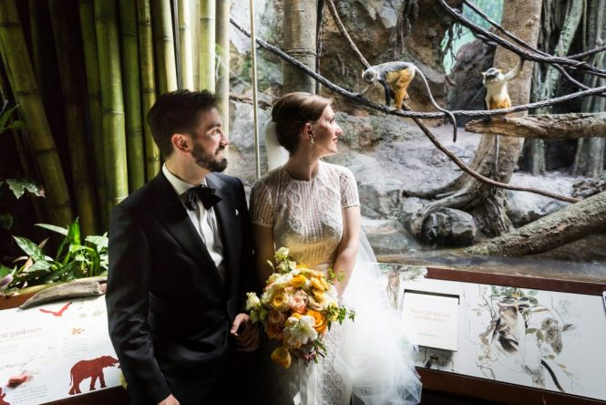 Bride and groom at zoo for an article on bouquet and garter toss alternatives