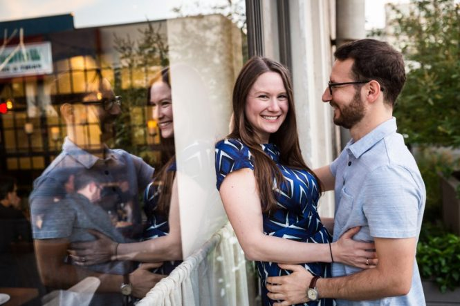 Couple dancing in front of a window before their ketubah signing
