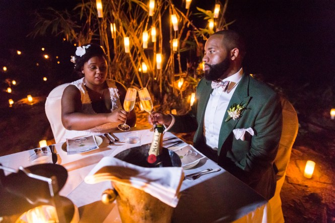 Bride and groom dining by candlelight for an article on destination wedding photography tips