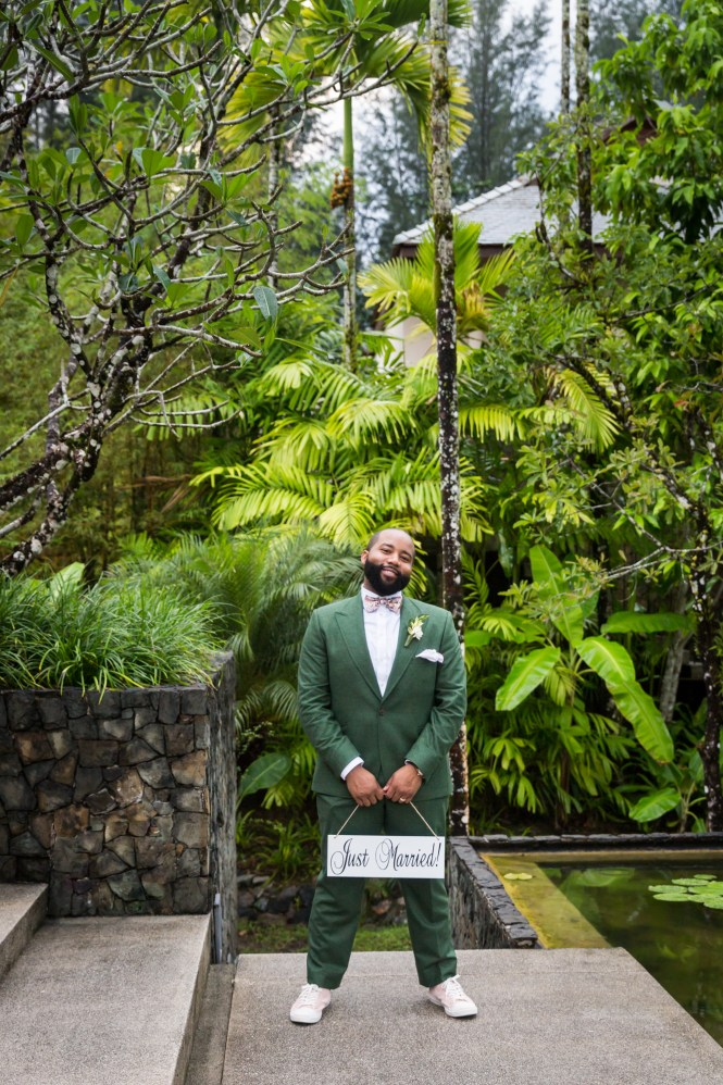 Groom with Just Married sign for an article on destination wedding planning tips