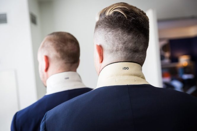 Grooms with embroidered tuxedo jackets at a same sex wedding celebration in Washington DC