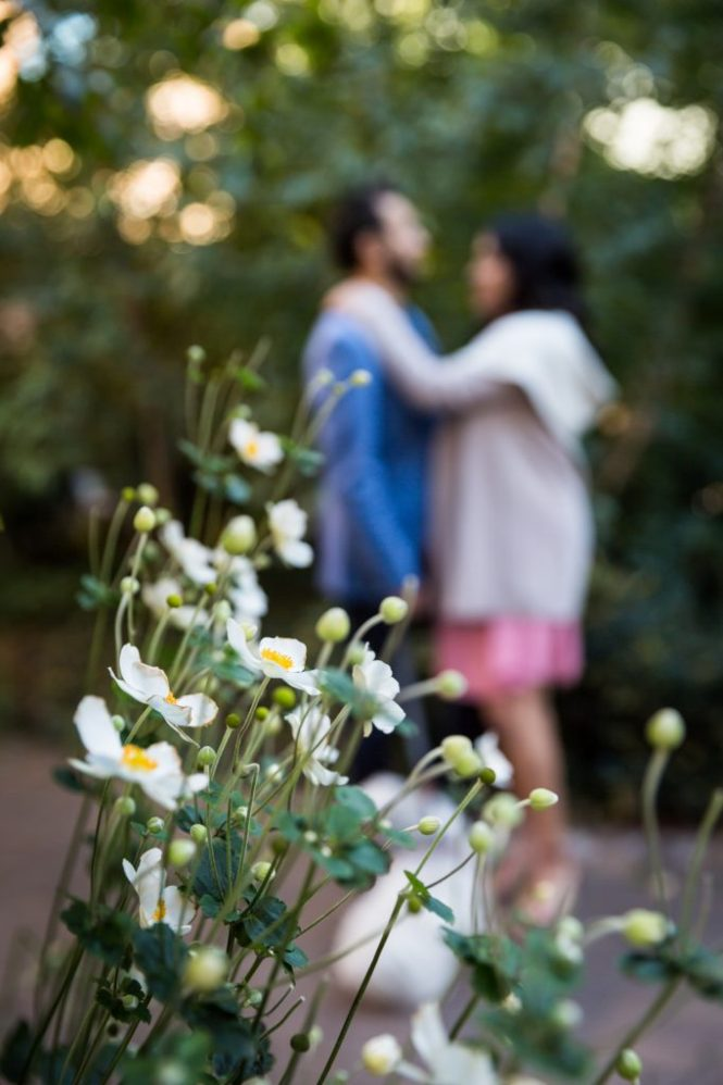 Portrait of a mother-to-be and husband with flowers for an article on maternity portrait tips