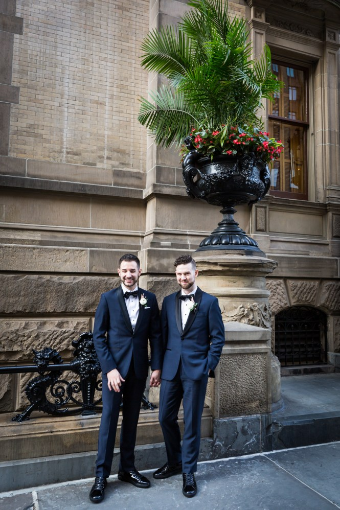 Two grooms in front of the Dakota