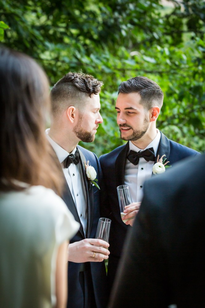 Two grooms giving toast for an article entitled, 'Do you need a permit to get married in Central Park?'