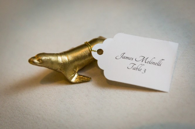 Gold seal escort card for an article on Bronx Zoo wedding venue updates