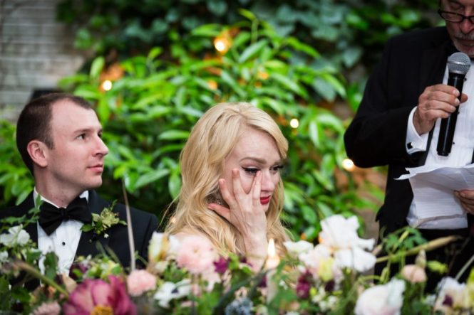 Bride crying during toast at a Central Park Conservatory Garden wedding