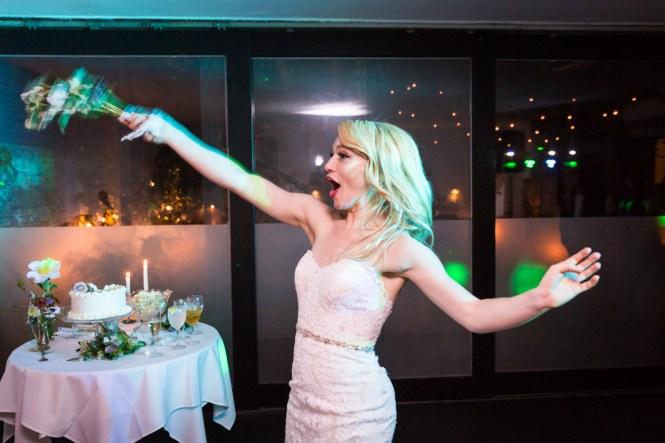 Bride throwing bouquet at a Central Park Conservatory Garden wedding