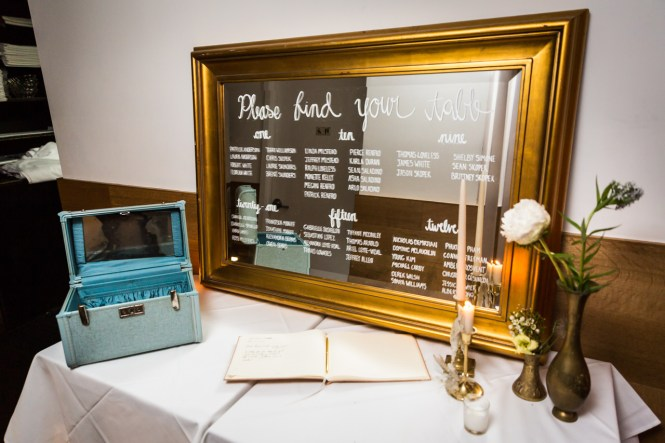 Seating chart on a mirror at a Central Park Conservatory Garden wedding