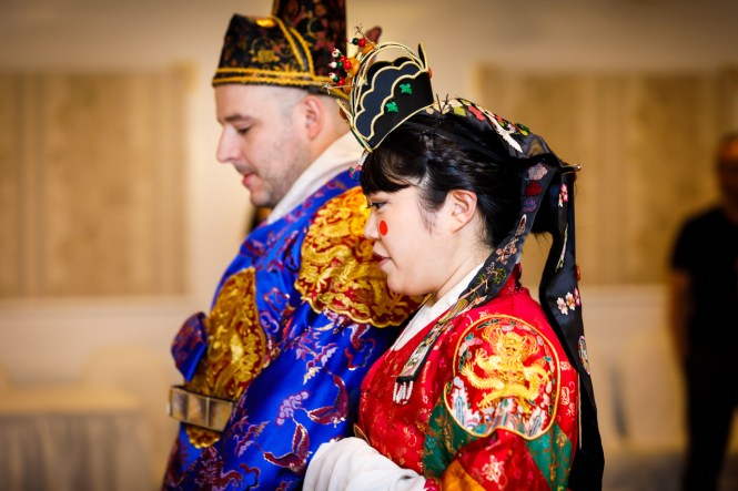 Bride and groom in profile at traditional Korean pyebaek ceremony