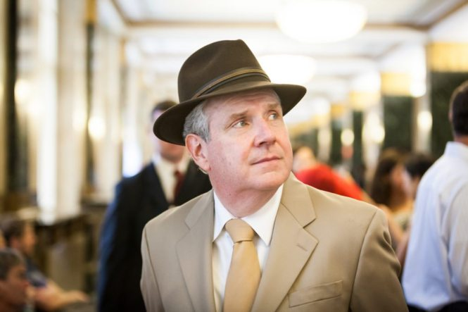 Dapper father of the bride in a fedora at a NYC City Hall wedding