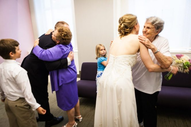Hugging after a NYC City Hall wedding, by Kelly Williams