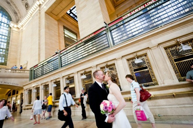 Bride and groom portrait in Grand Central after a NYC City Hall wedding, by Kelly Williams