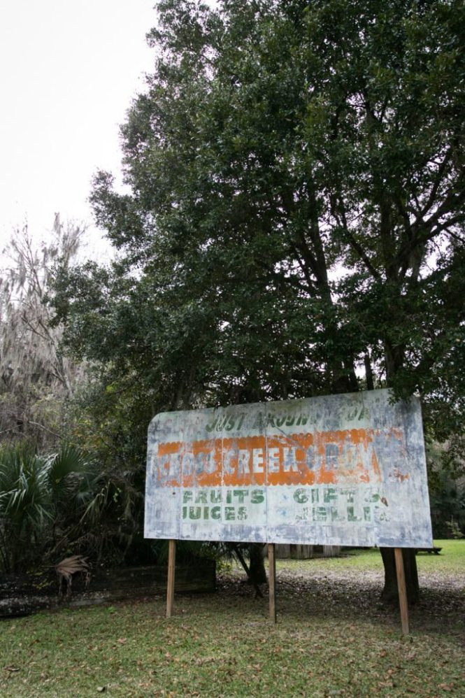 A fading sign selling citrus