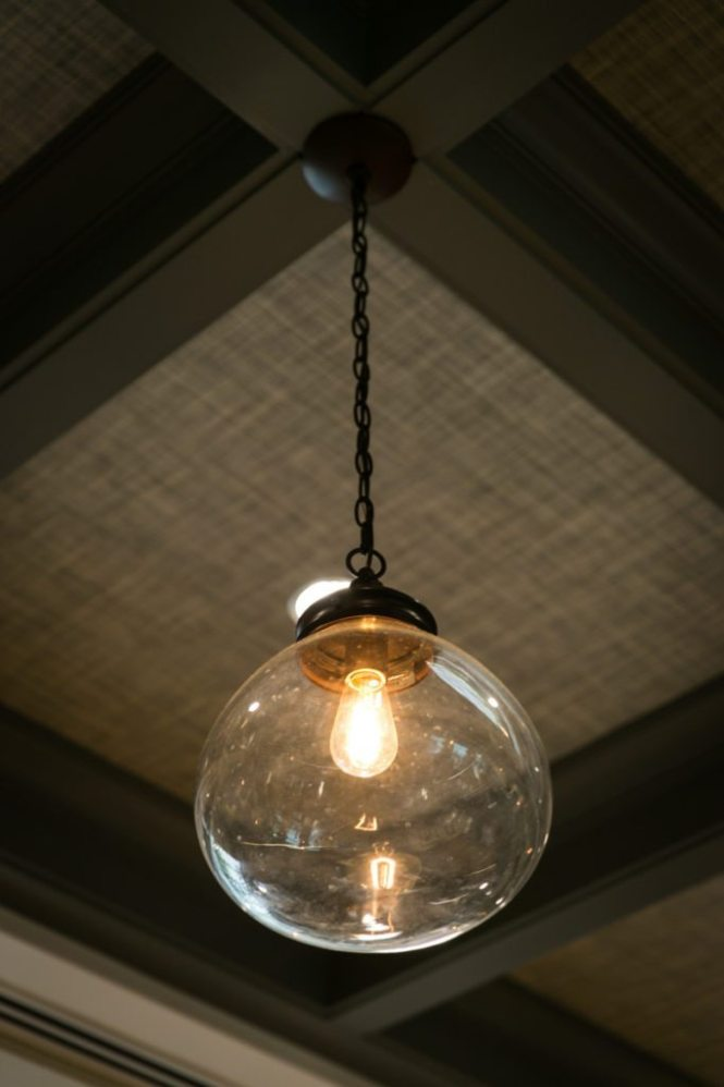Detail of a light fixture in the restaurant of the Oxford Exchange in Tampa, Florida
