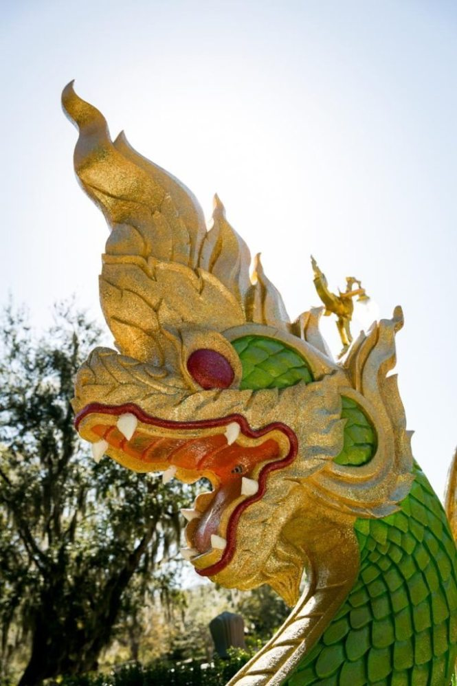 A dragon guards the exterior of the Wat Mongkolratanaram, photographed by NYC photojournalist, Kelly Williams