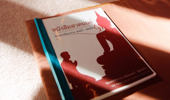 Worship guides at the Wat Mongkolratanaram, photographed by NYC photojournalist, Kelly Williams