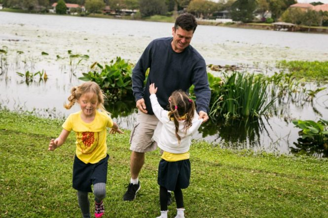 Family fun beside the lake by NYC family photojournalist, Kelly Williams, for an article on how to take the best family photos