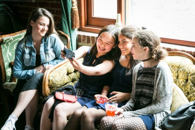 Kids having fun, by NYC bat mitzvah photographer, Kelly Williams