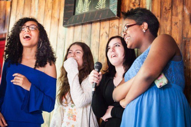 Kids performing karaoke, by NYC bat mitzvah photographer, Kelly Williams