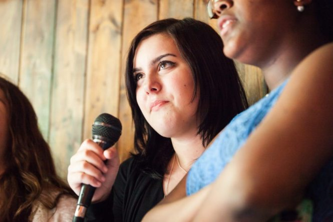 A girl performing karaoke, by NYC bat mitzvah photographer, Kelly Williams