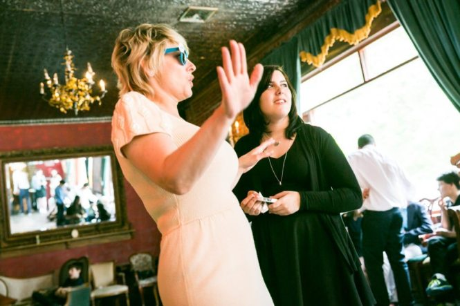 A karaoke performance, by NYC bat mitzvah photographer, Kelly Williams