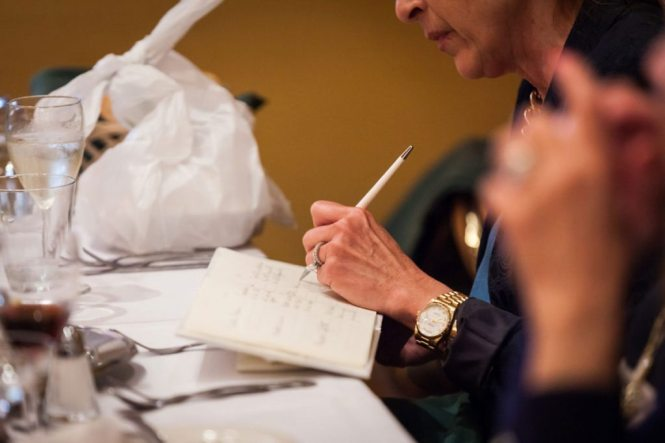 Signing the guest book by Bay Ridge wedding photographer, Kelly Williams