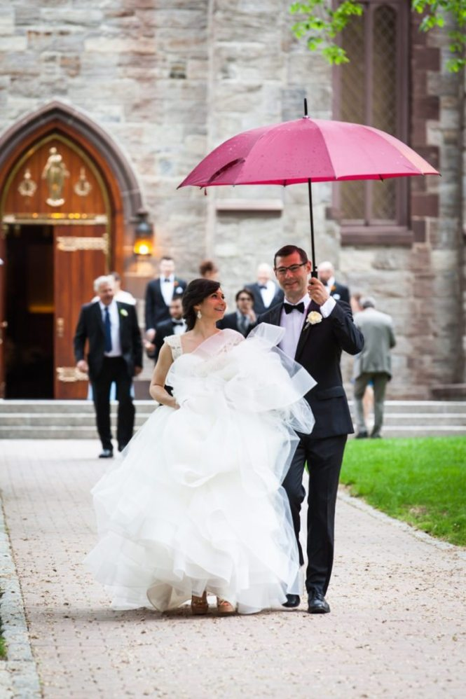 Bride and groom leaving a Fordham University Church wedding ceremony