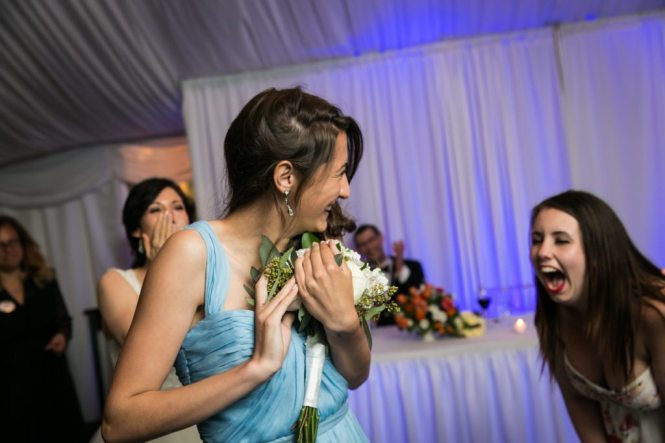 Bouquet toss at a Pelham Bay & Split Rock Golf Club wedding reception
