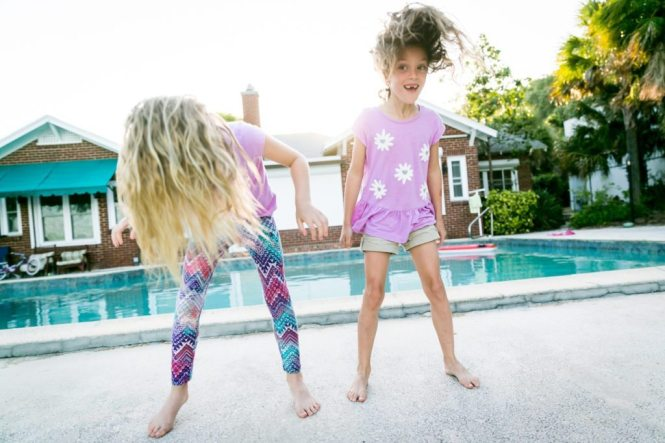 Fun family portraits in Florida by portrait photographer, Kelly Williams