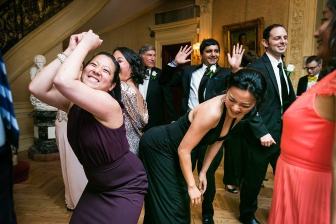 Guests dancing at a Columbus Citizens Foundation wedding by NYC wedding photojournalist, Kelly Williams