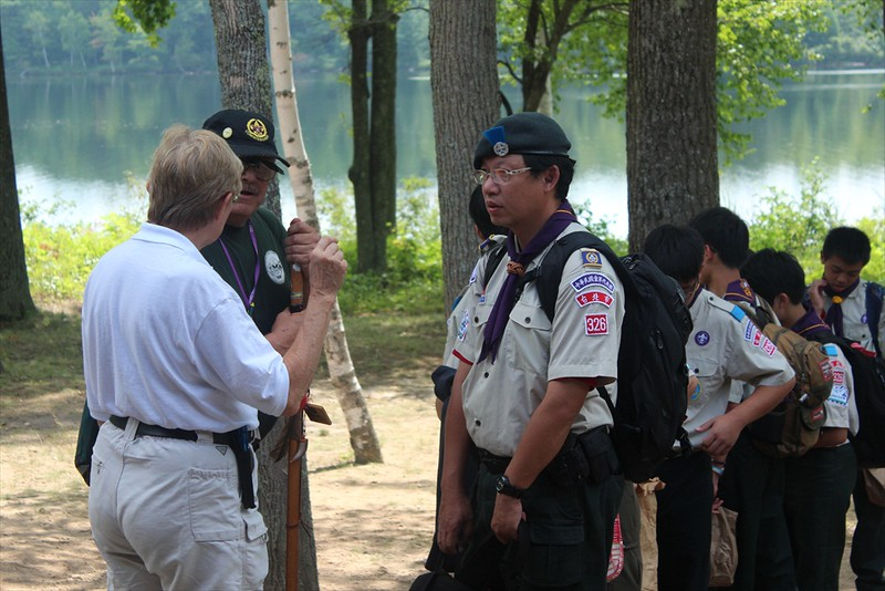 Scouts checking in with leaders by a lake