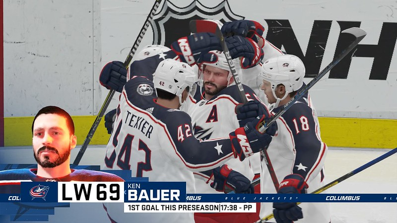 A PS4 screenshot of NHL20, celebration after scoring a goal.