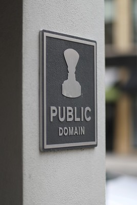 "Image of a plaque on a wall with a stamp and the words ""PUBLIC DOMAIN"""