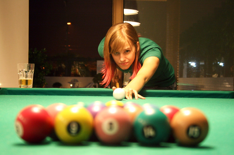 A player lining up a break at a snooker table.