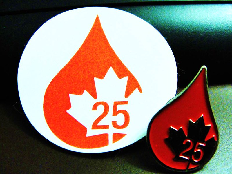 Pin and sticker given for 25th blood donation in Canada.