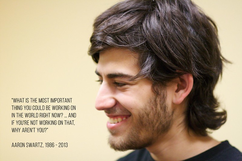 """Image of Aaron Swartz with his quote """"What is the most important thing you could be working on in the world right now? ... And if you're not working on that, why aren't you?"""""""