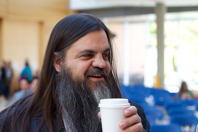 A picture of a friend (Bryan Alexander) drinking coffee taken by a friend (Alan Levine).