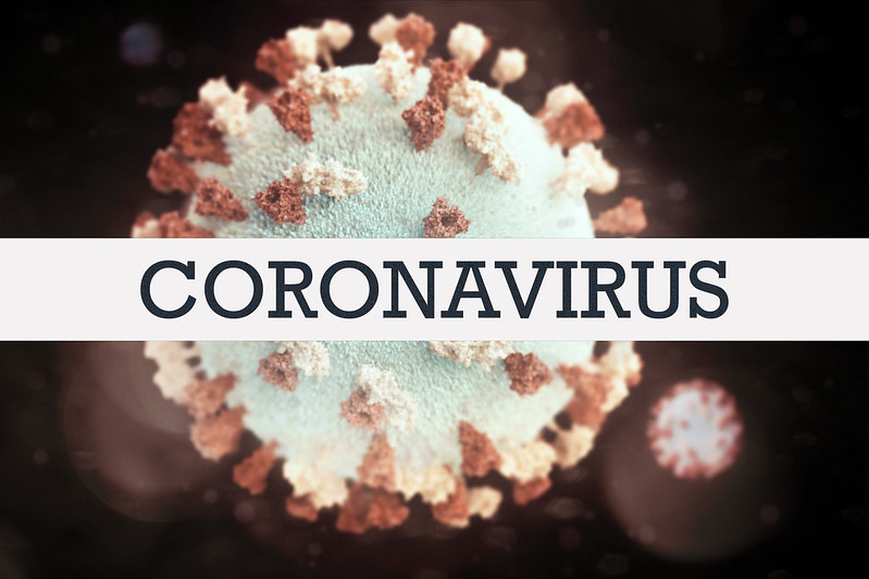 "Image of SARS-CoV-2 and text ""CORONAVIRUS""."