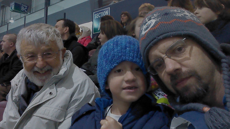 Hockey with Dad and Adrián. At a Victoria Grizzlies hockey game.