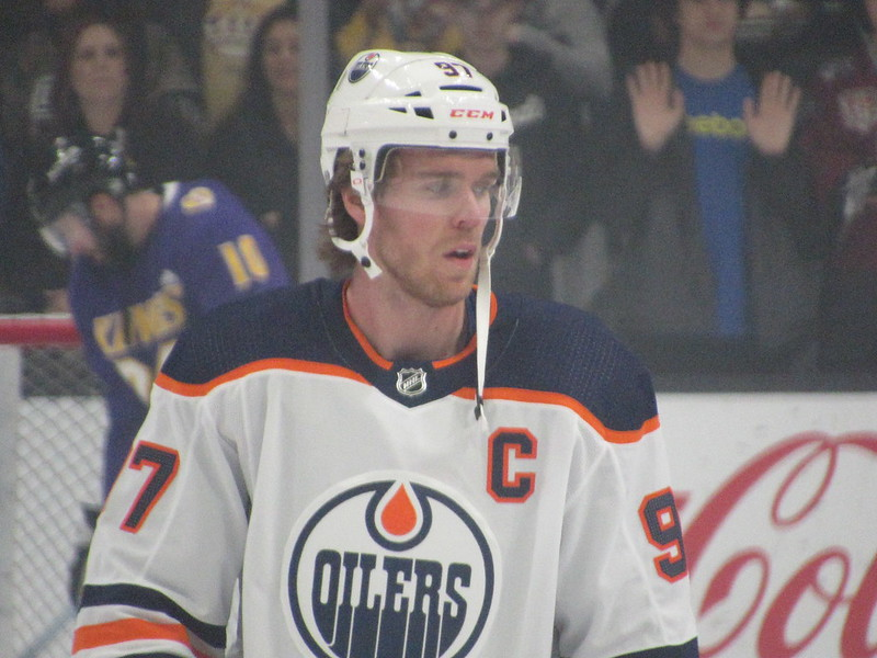 Photo of Connor McDavid on ice during a game against the Los Angeles Kings in what appears to be the 2019-2020 season.