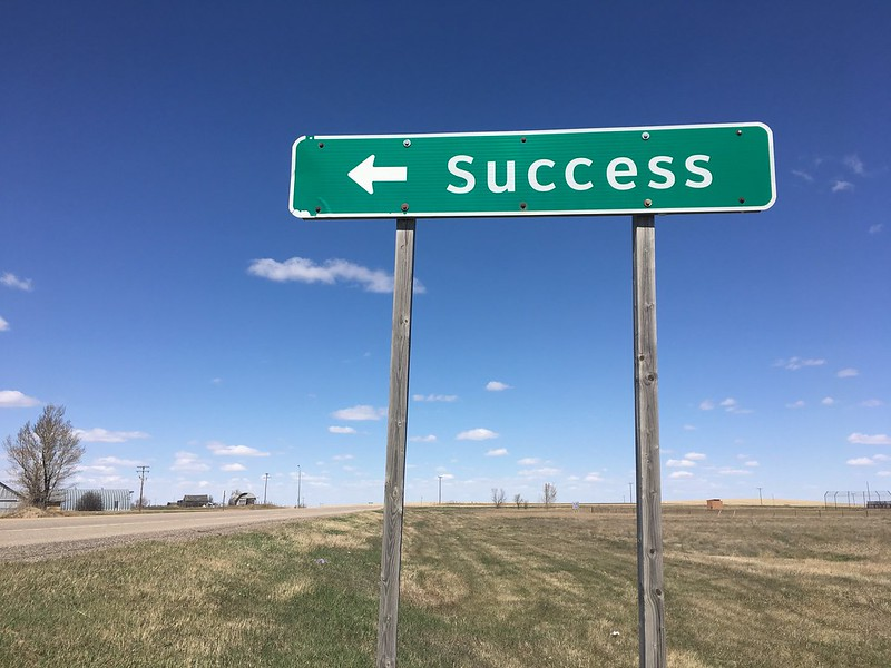 """Road sign pointing to """"Success"""". It's a side trip on the road to Leader, SK. Oh the town names, Elbow to Eyebrow, etc..."""