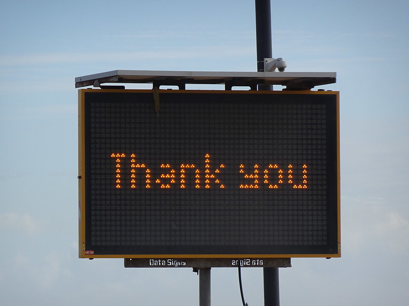 """Digital road sign with the words """"Thank you""""."""