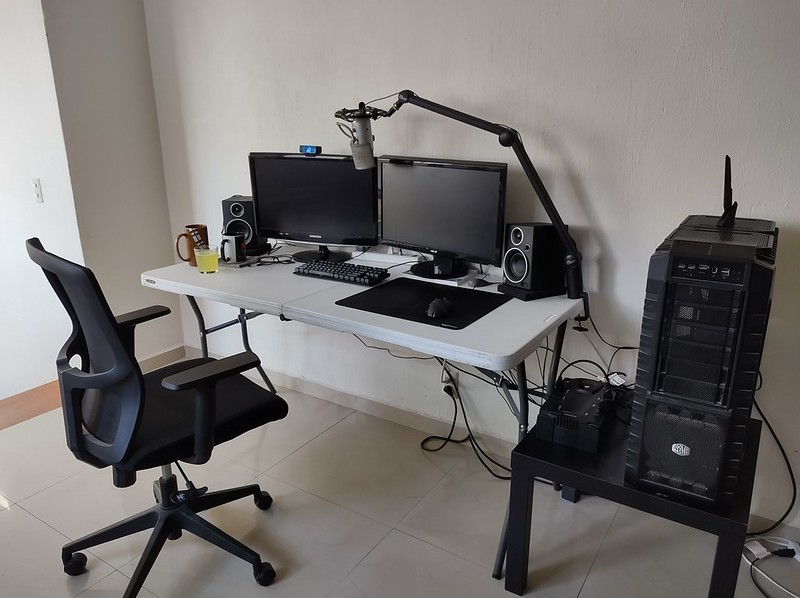 Desktop computer with office chair setup on a folding table.