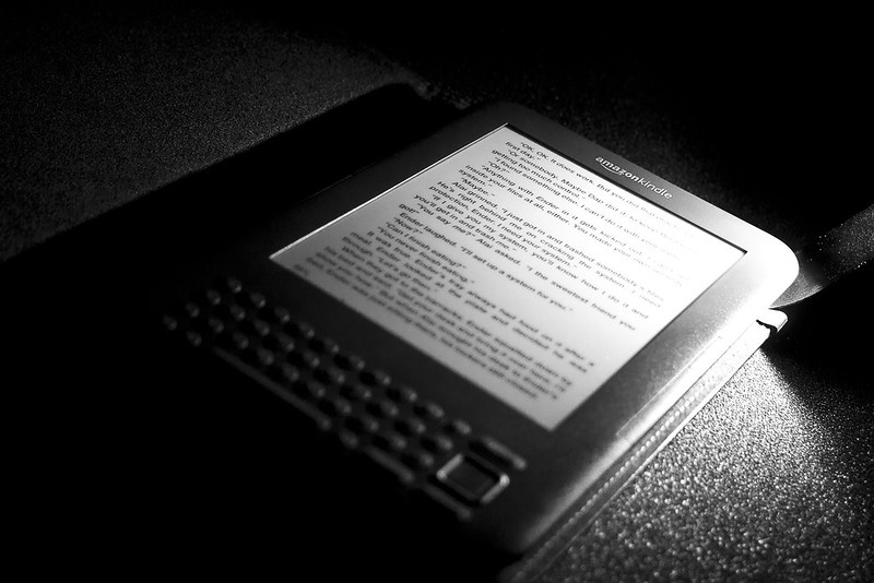 Black and white picture of an Amazon Kindle reader.