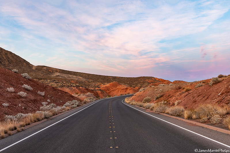 """View from a car looking """"around the bend"""" of a road near Lake Mead National Recreation Area in Nevada."""