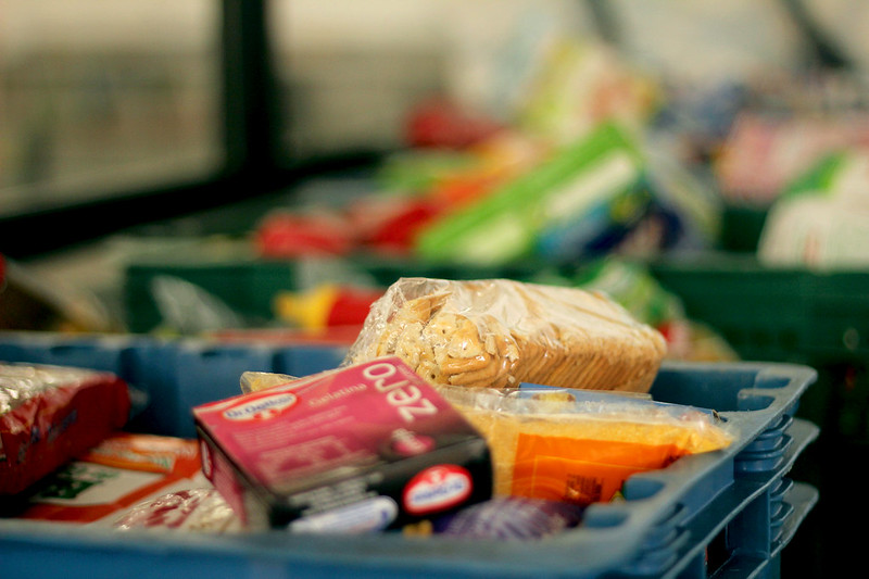 Close-up of a carry tote full of goods for a food bank delivery.
