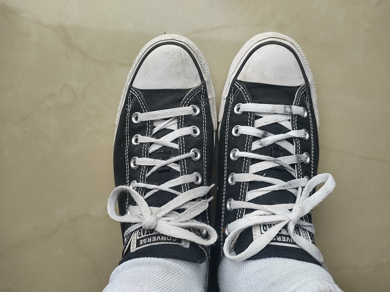 Picture of black Converse All Stars low-top shoes. My first time wearing two shoes in almost two months.