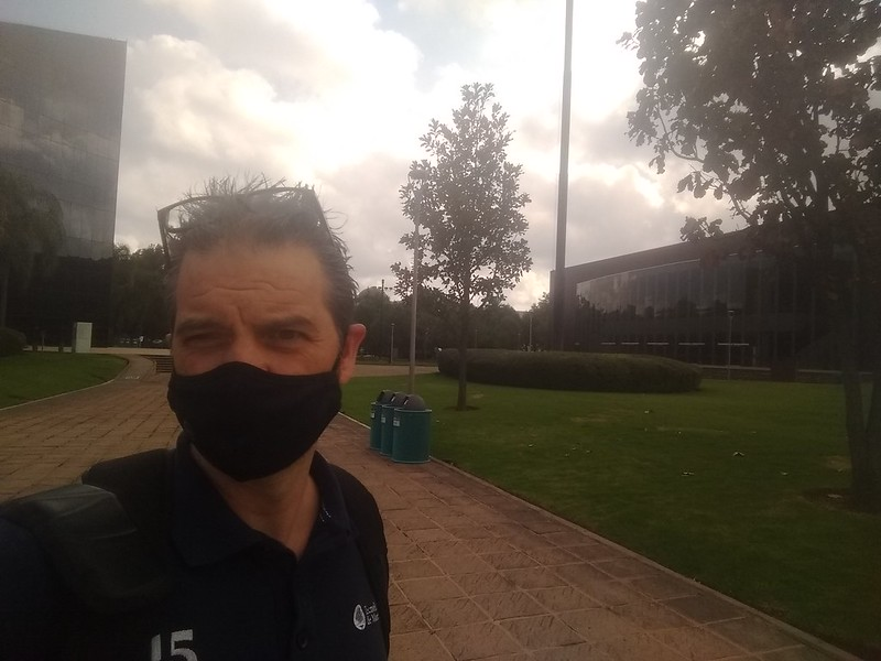 Selfie with a cloth mask during covid19 times take at the Tec de Monterreyu in Guadalajara. Conference center visible in the background.